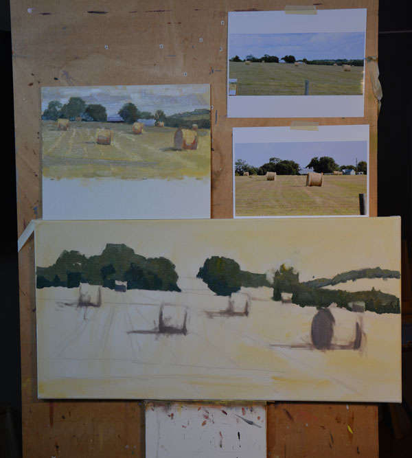 Creating a studio painting using reference material.