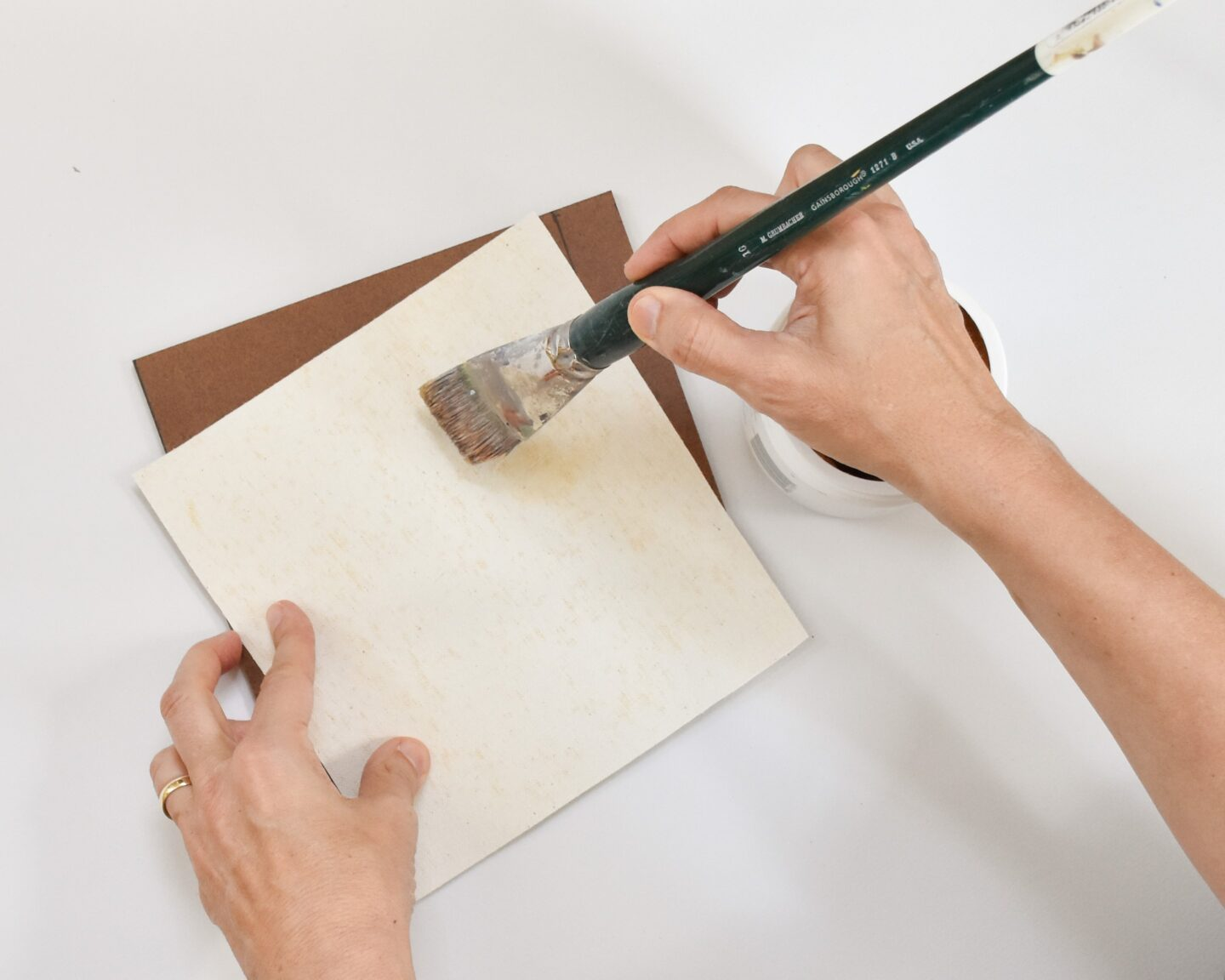 glueing canvas to a masonite support
